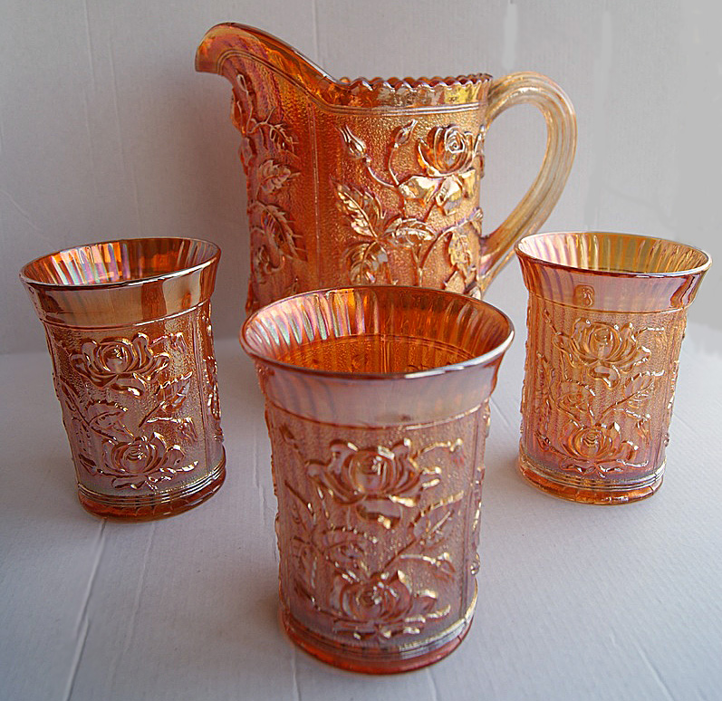 Lustre Rose pitcher and three tumblers in marigold.