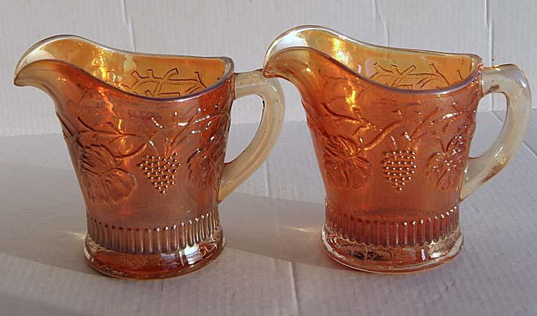 A pair of marigold Reisling creamer jugs.