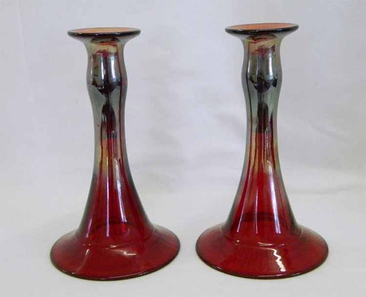 Pair of Mae West candlesticks - red, pale iridescence