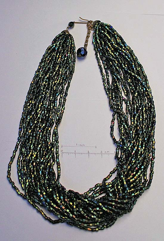 multi strand necklace, with dark green iridescence